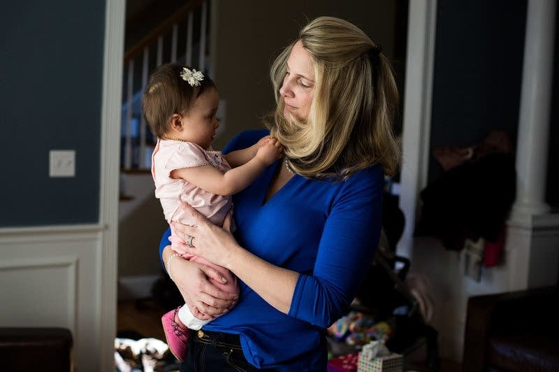Alicia Nichols holds her daughter Diana in her home in February.
