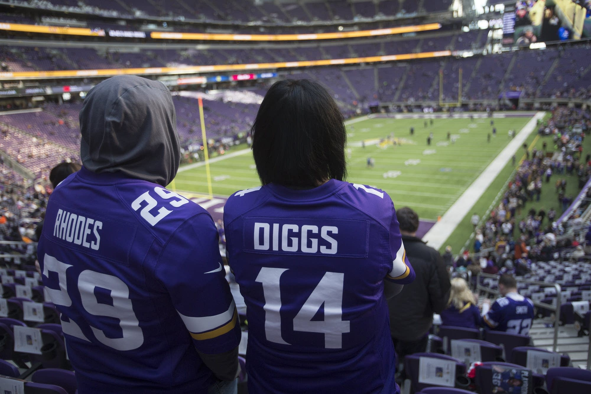 Fans watch preparations on the U.S. Bank Stadium field before the game.