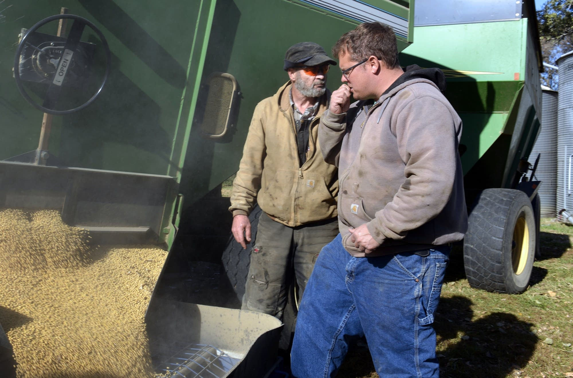 Jesse Hall (right) and Jim Finnegan check the quality of soybeans.