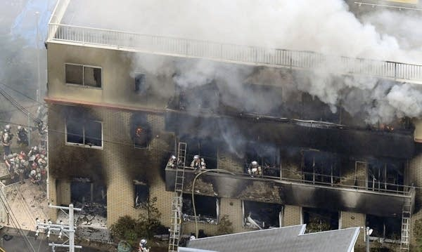 Firefighters respond to a building fire of Kyoto Animation in Kyoto.
