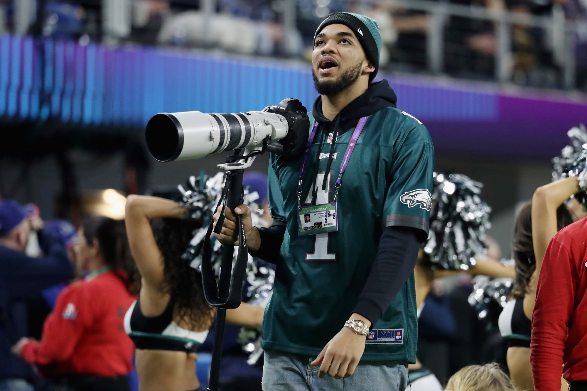 Karl-Anthony Towns of the Timberwolves on the sidelines as a photographer.