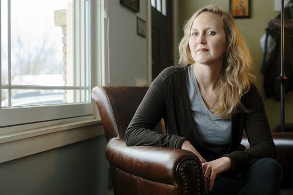 Lora Den Otter sits for a portrait