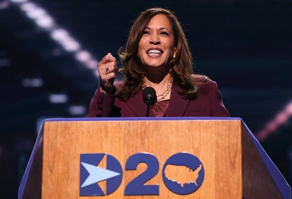 A woman speaks at a podium.