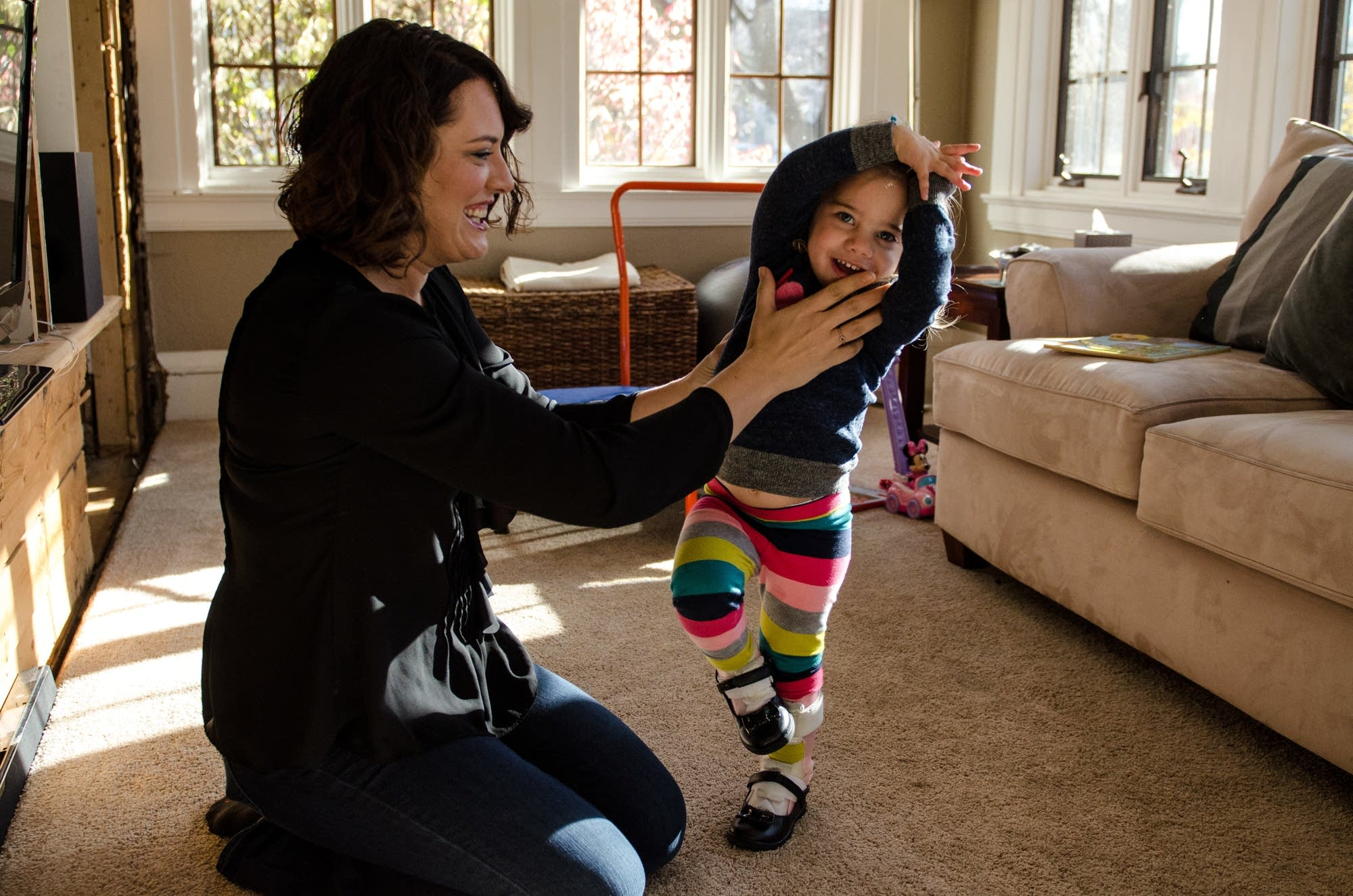 Leah Henrikson and her daughter Vivian play.