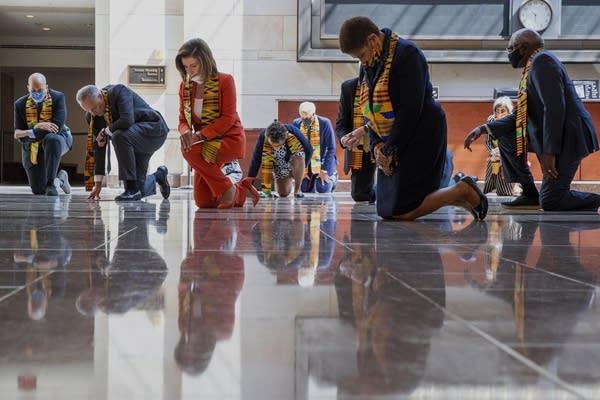 Members of Congress kneel in honor of George Floyd.