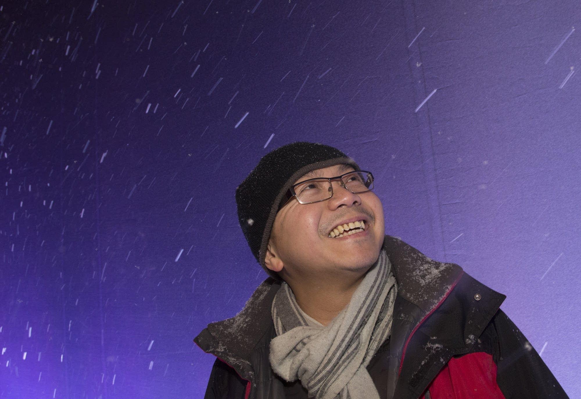 Don Do of Woodbury enjoys the snowfall on Nicollet Mall.