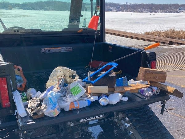 Trash collected on a frozen lake