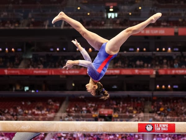 A gymnast competes on beam