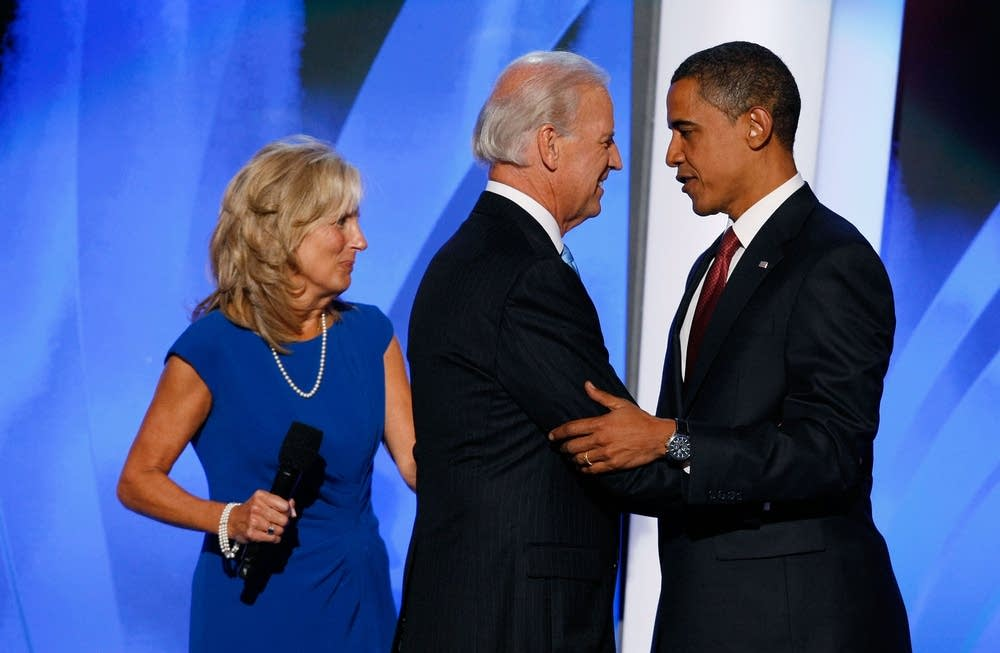 Barack Obama greets Joe Biden on stage