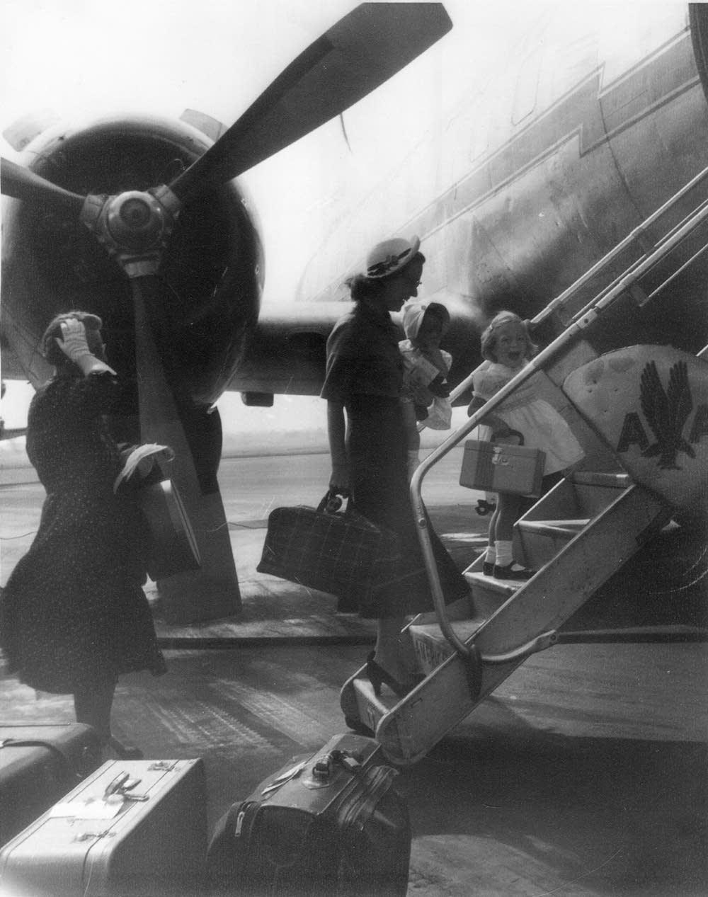 Boarding a plane, 1957