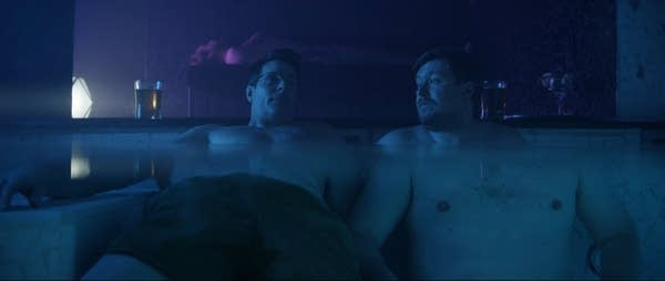 Dennis and Edward sit in a hot tub in Amazon's Patriot