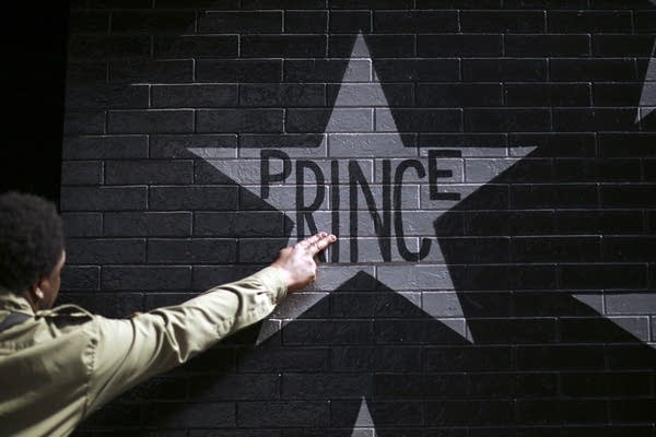 A fan touched Prince's star on the wall.