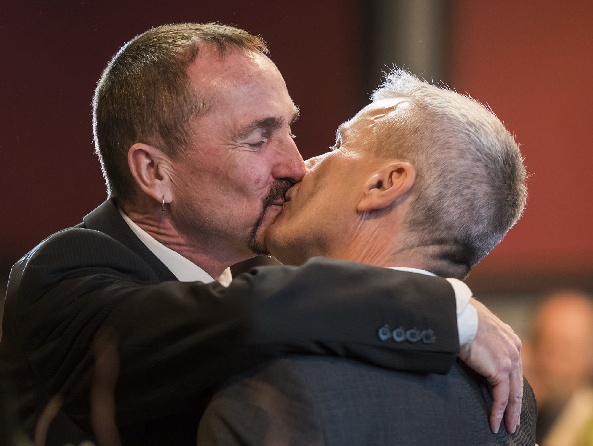 Germany's first gay couple to be legally married kiss