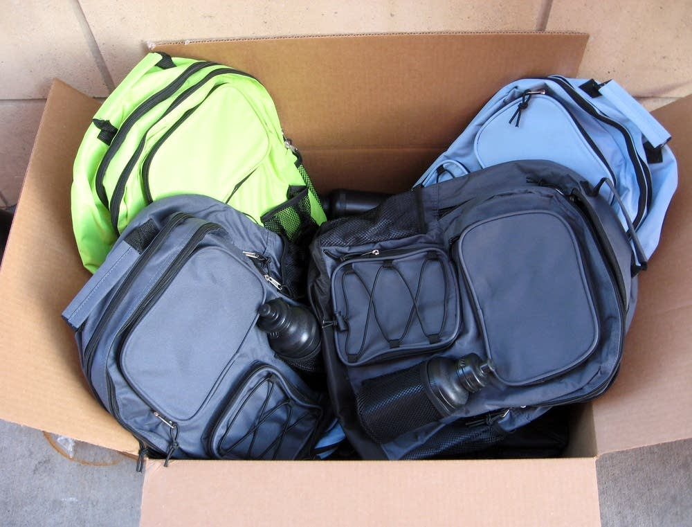 A box of donated backpacks