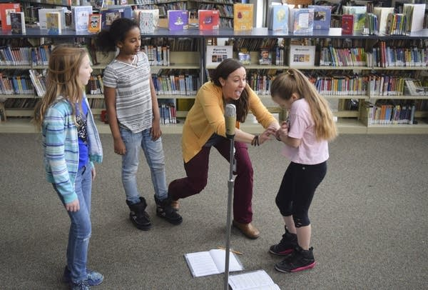 Aria Urban, 11, Tsedenia Bezie, 9, and Michelle Allen, 11, practice lines.