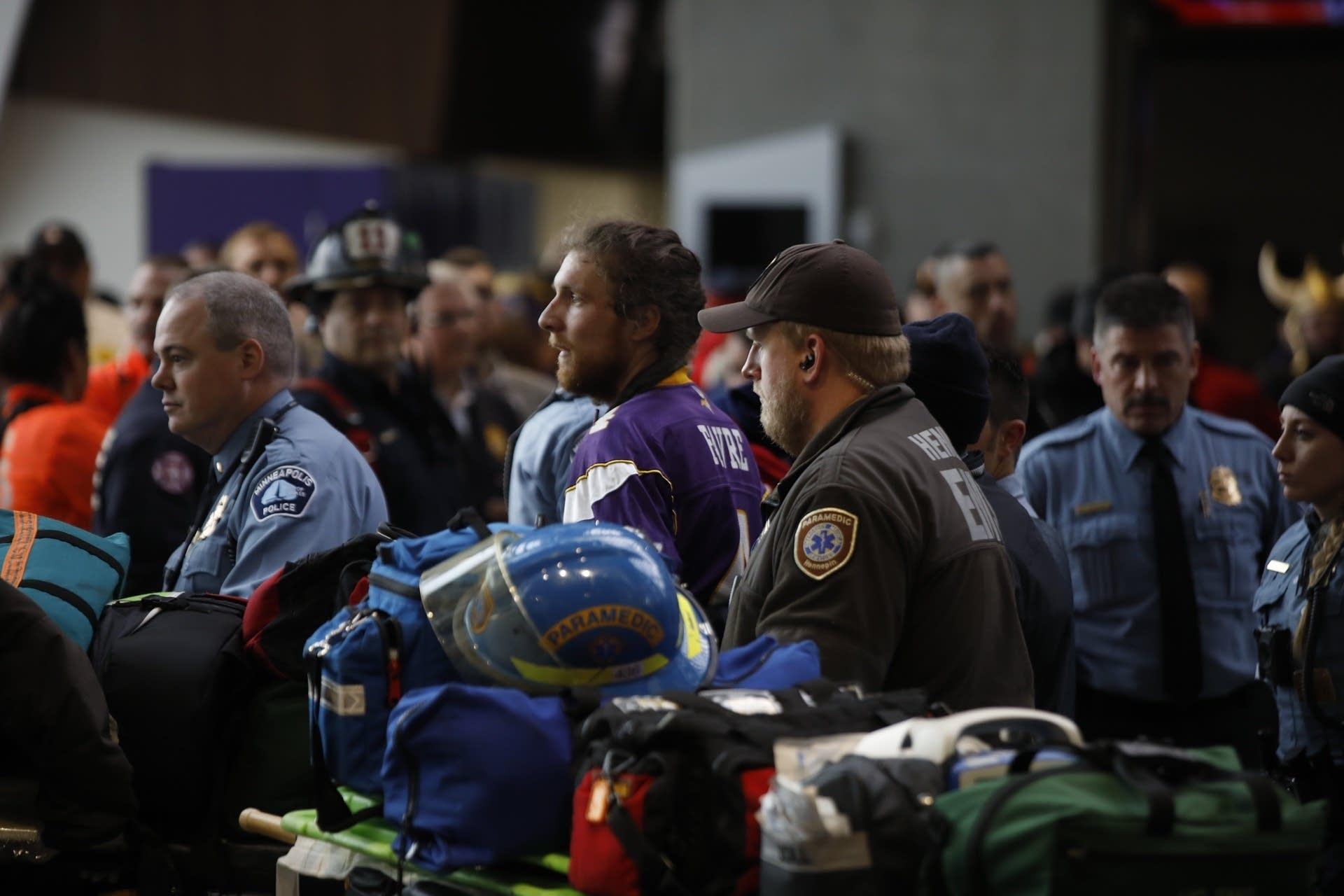 Paramedics escort a protester.