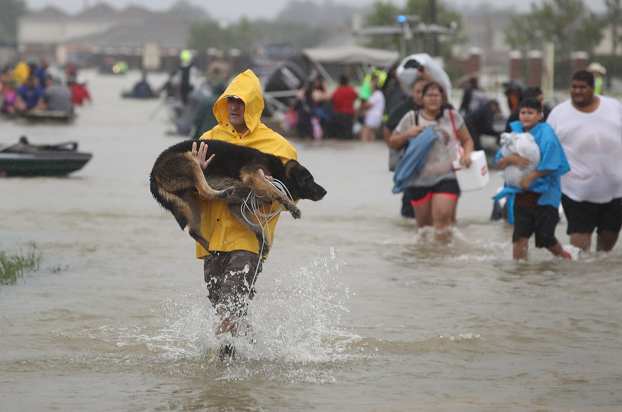 People evacuate their homes after the area was inundated.