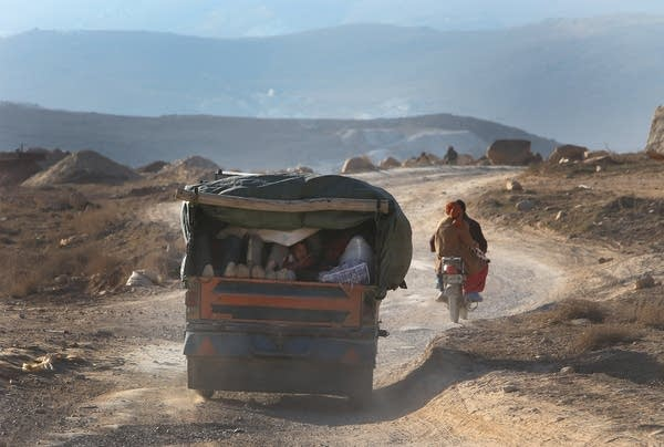 Fleeing fighting in the mountains of Syria