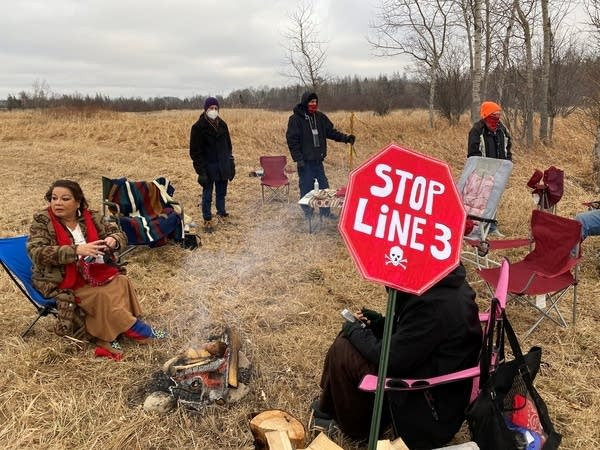 About 20 people gathered for a small protest against the Line 3 project.