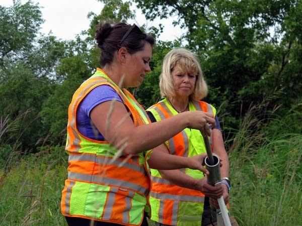 DNR hydrologists Erynn Jenzen, left, and Brenda Stauffer