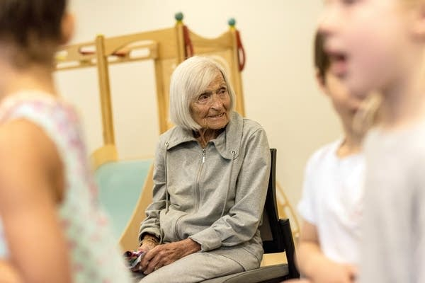 Ruth Knelman smiles as students enter a room at the Early Childhood Center.