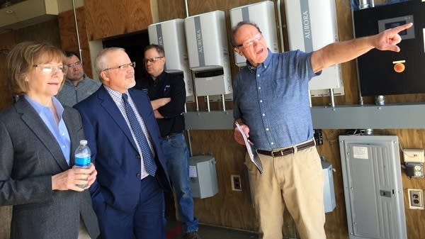 Steve Vietor points out the Riverland Community College's wind turbine.
