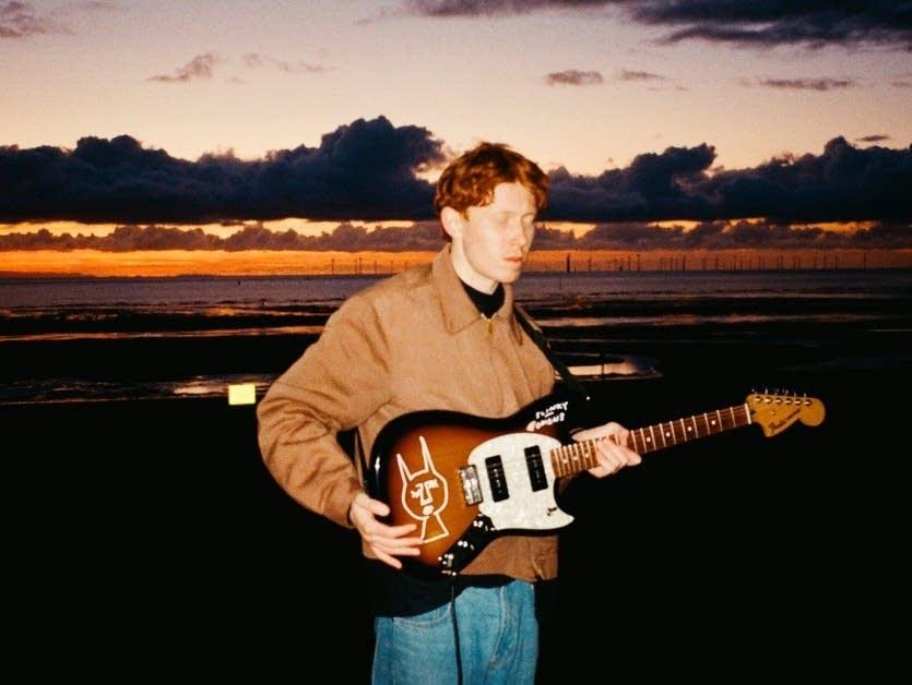 King Krule, young man sunset, guitar