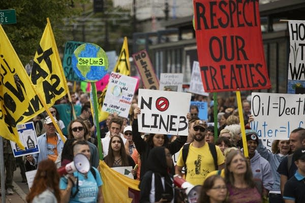 Anti-pipeline protesters march from the Capitol on Thursday, Sept. 28.