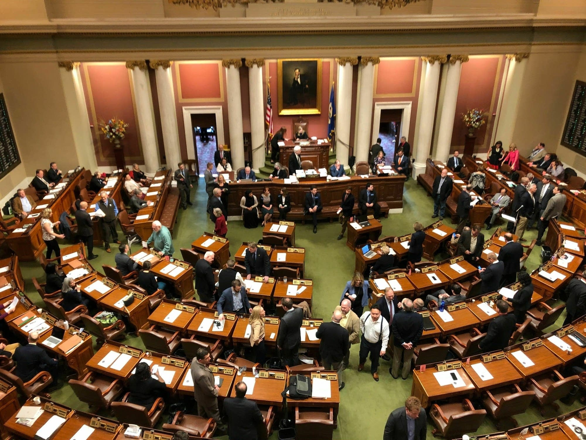 Representatives gather on the floor of the Minnesota House