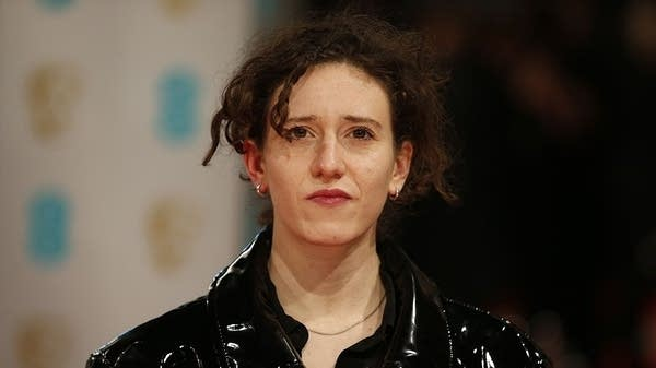 Mica Levi poses on the red carpet for the BAFTA Film Awards