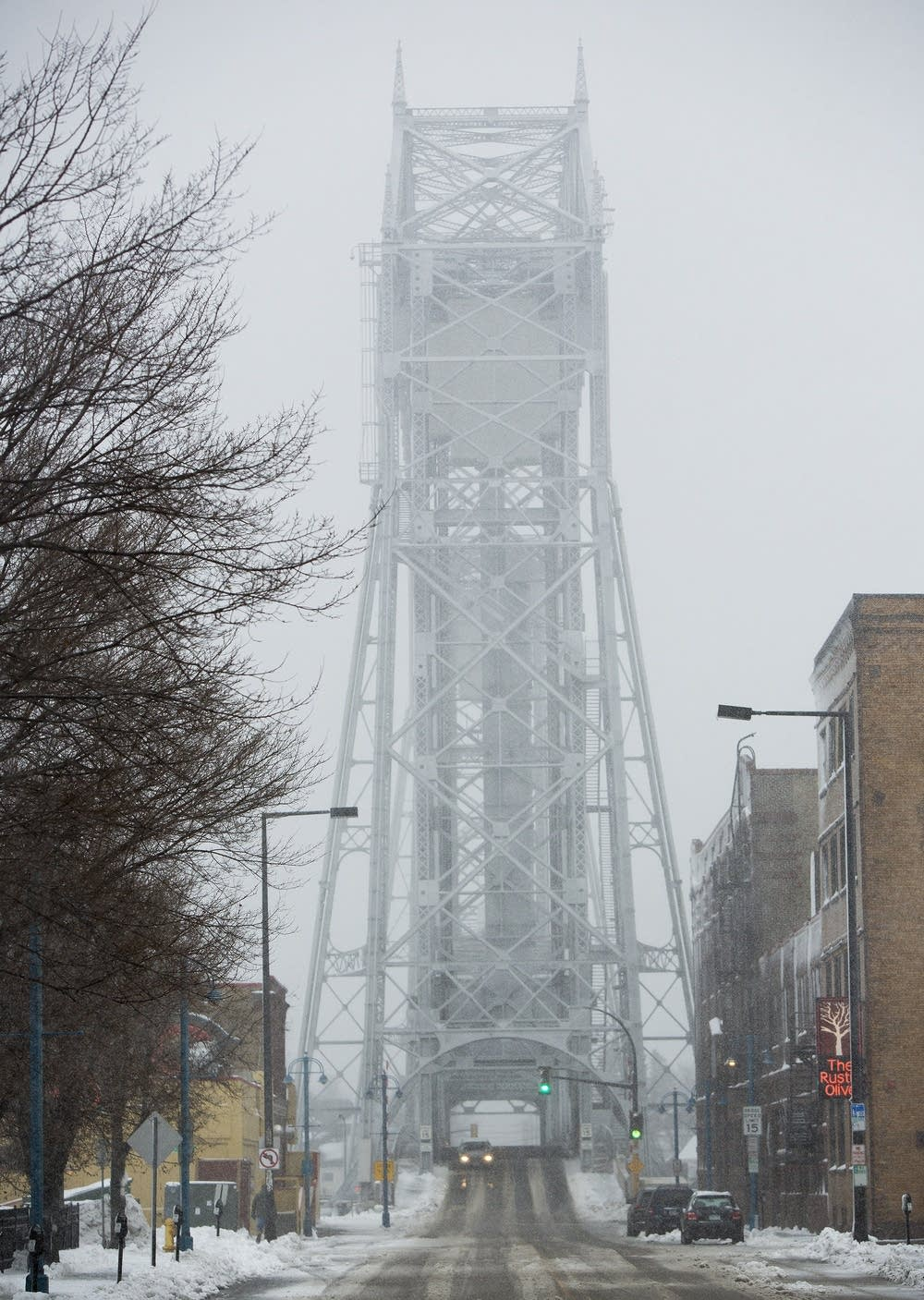 Blowing winds obscure the view of the lift bridge.