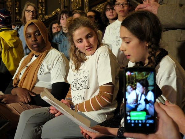 Thirteen-year-old Olya Wright reads a statement on youth climate action.