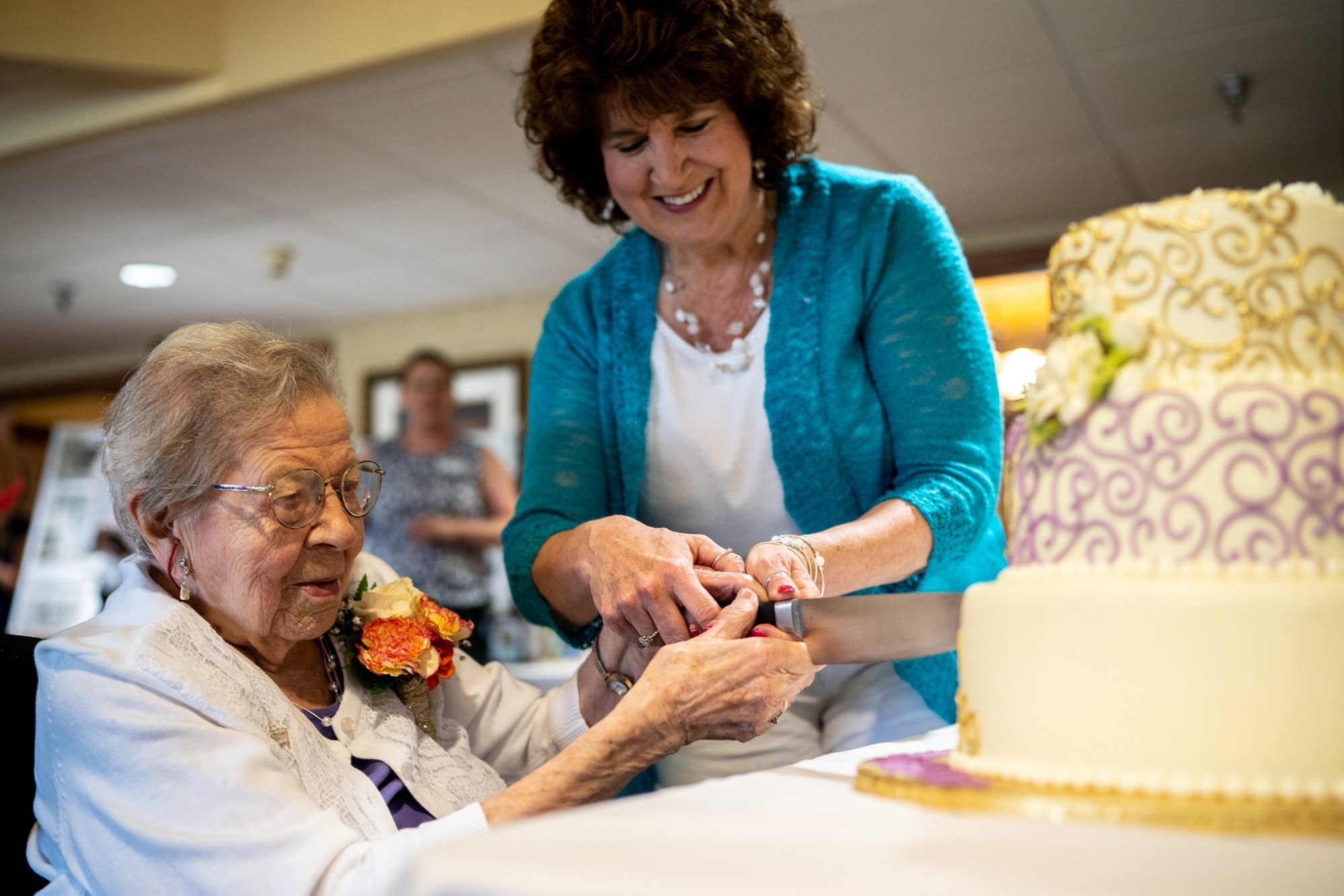 Evelyn Kleine cuts into her birthday cake.