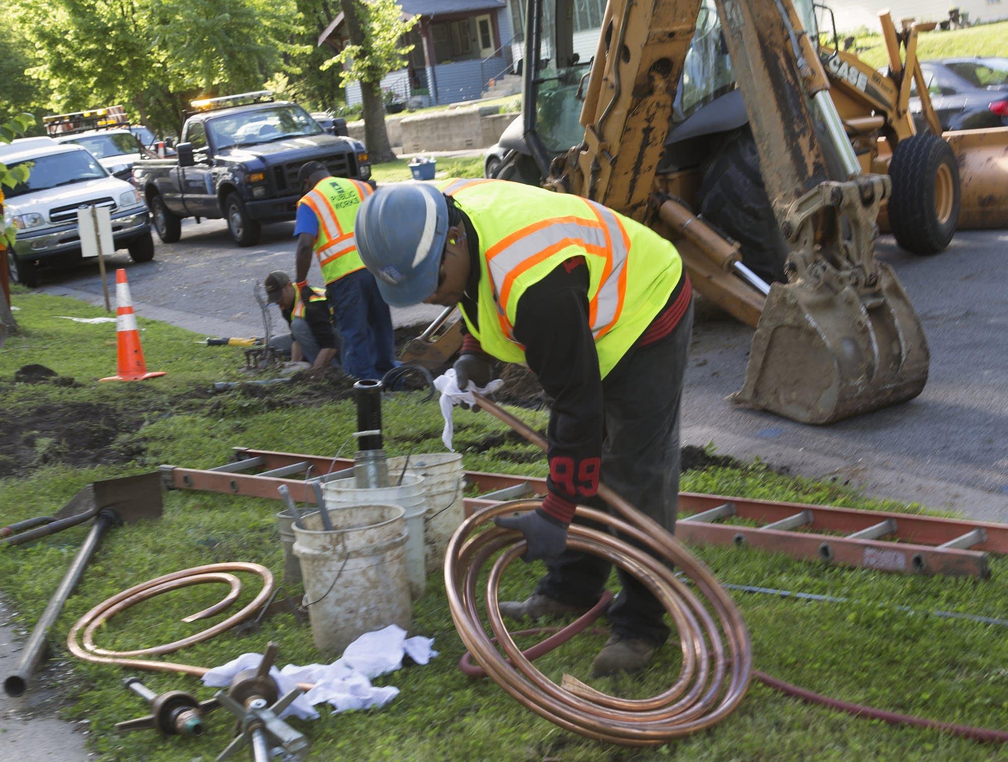 Randy Barnes prepares copper pipe.