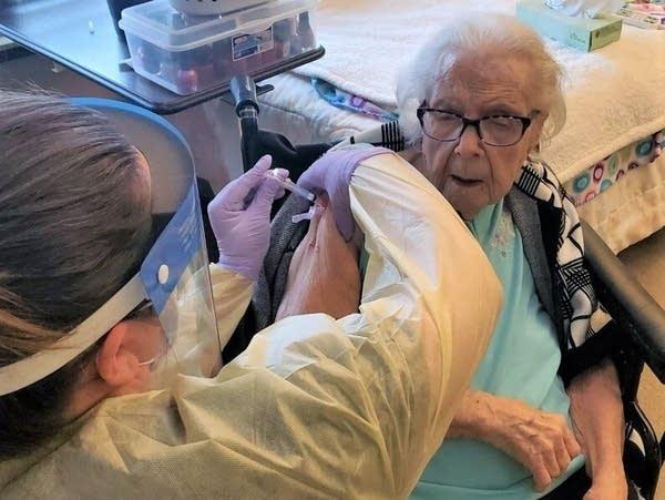 Harriet Lobbins, 106-year-old nursing home resident, receives a vaccine.
