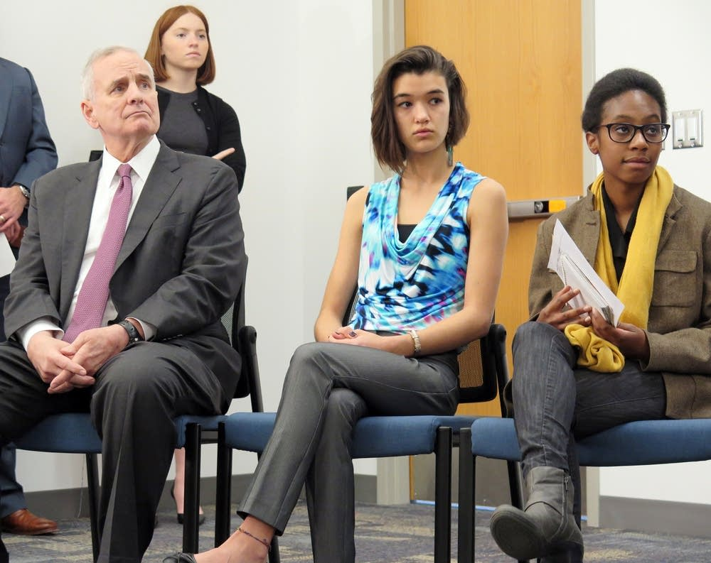 Dayton listens to students talk about climate.