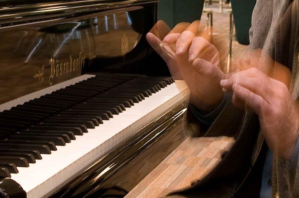Musicologist Uwe Kliemt at keyboard.