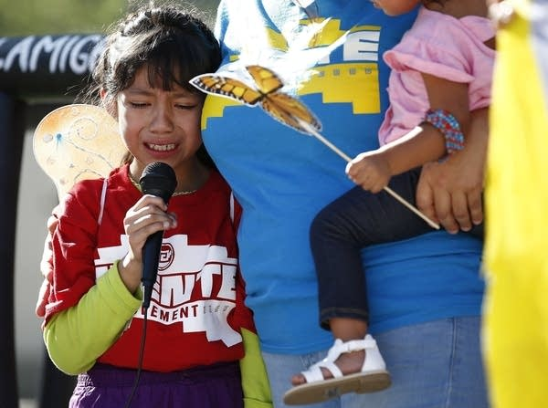 Akemi Vargas, 8, cries as she talks about being separated from her father.