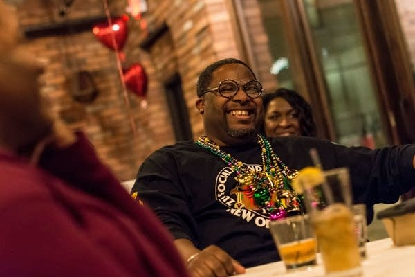 Raazon King of Minneapolis laughs while attending Dessert and Discussion.