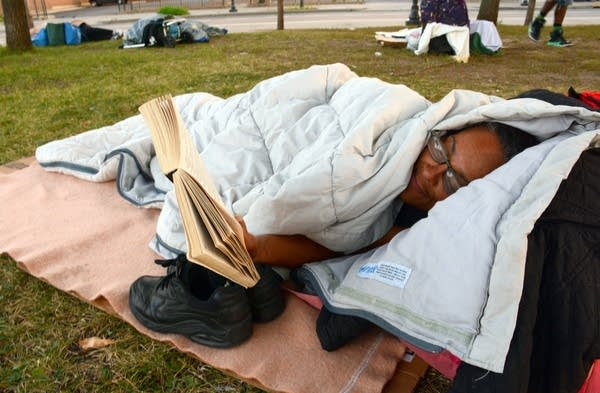 Tish Bell rests outside the Dorothy Day Center
