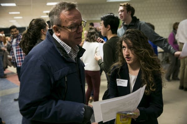 A DFL student guide helps a constituent to his caucus