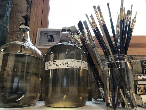 Annie Hejny's studio in Minneapolis features jugs of water.