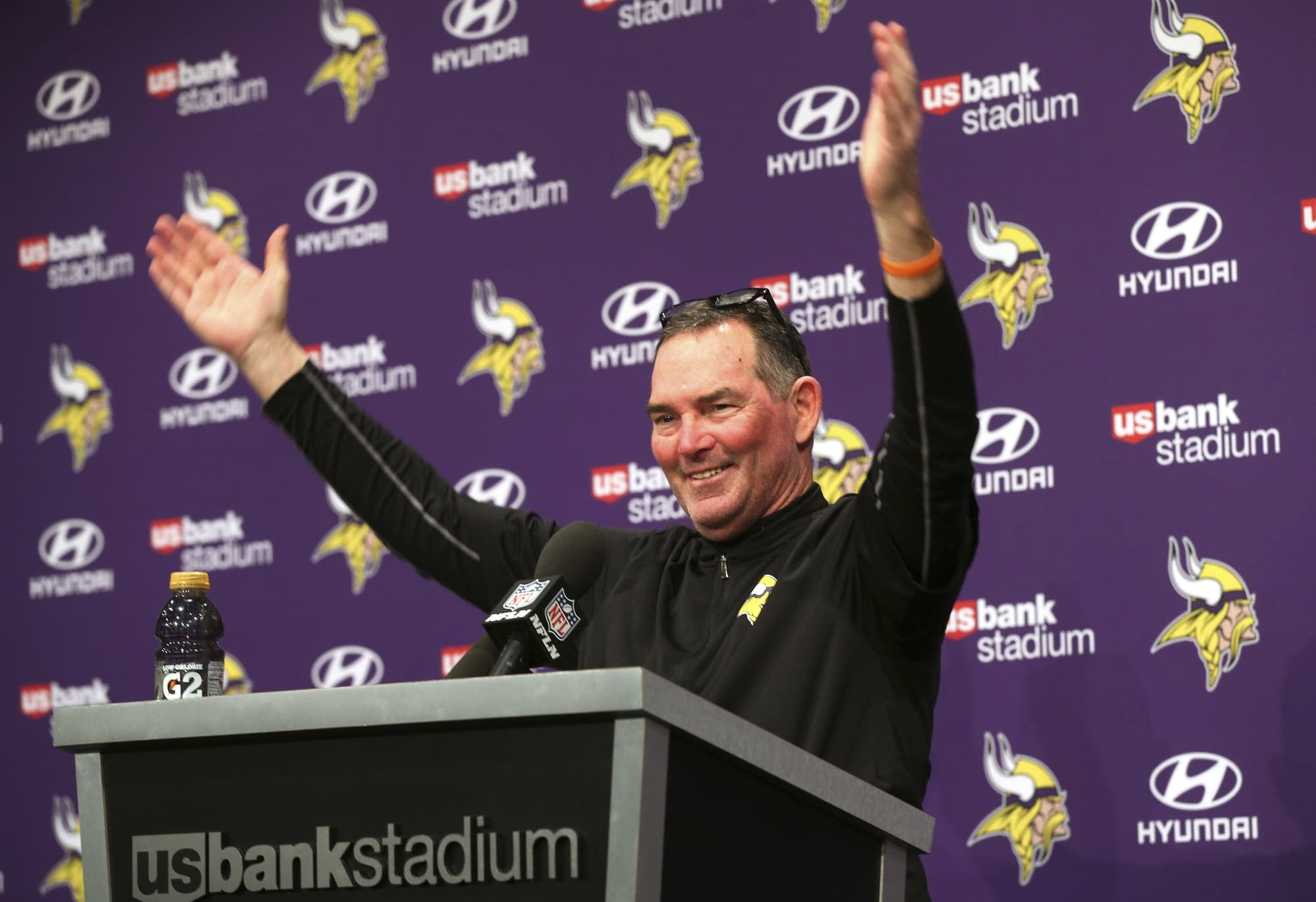 Coach Mike Zimmer waves as fans looked into his post-game press conference.