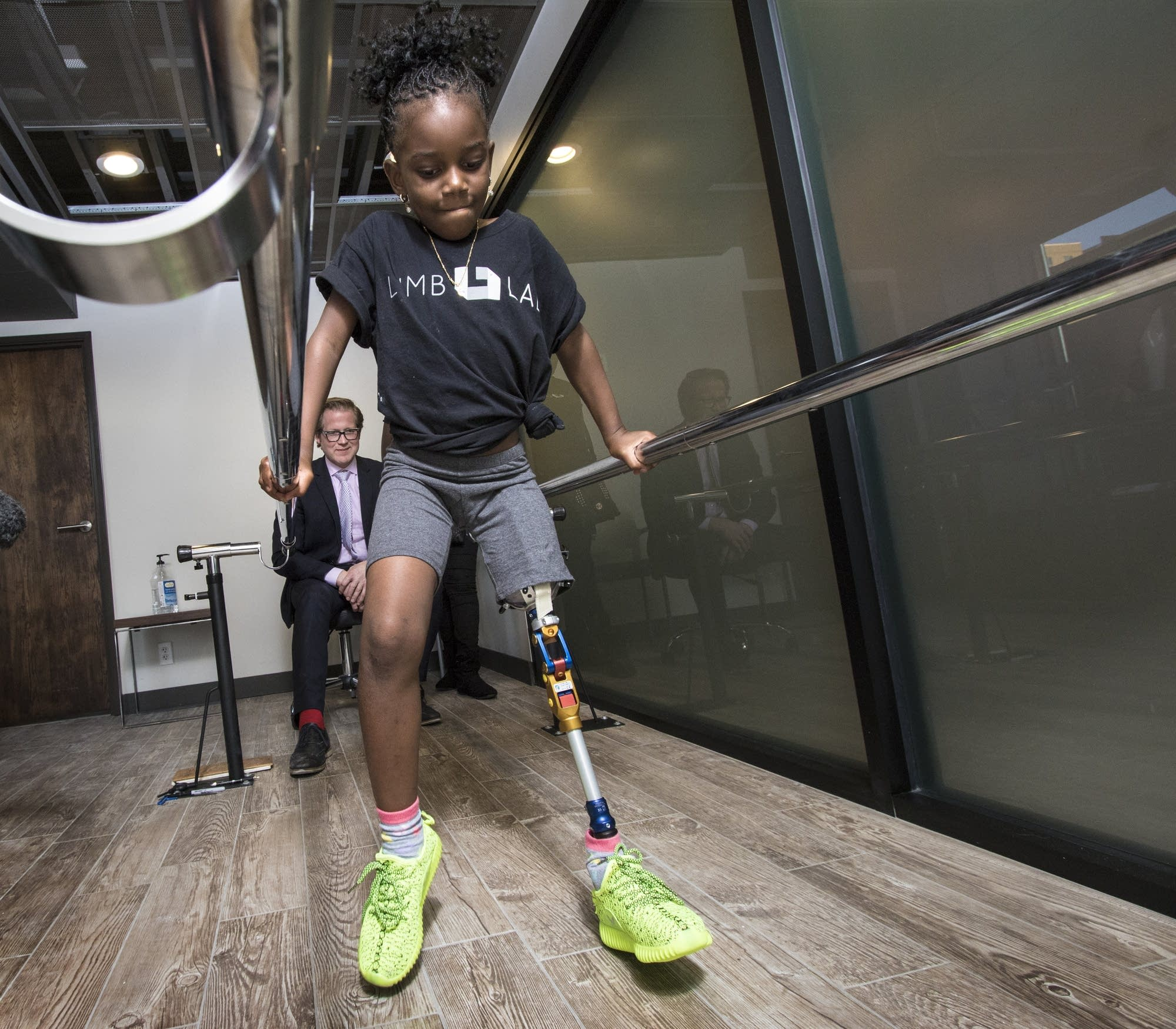 Rusheka Goodhall tests a new prosthetic leg.