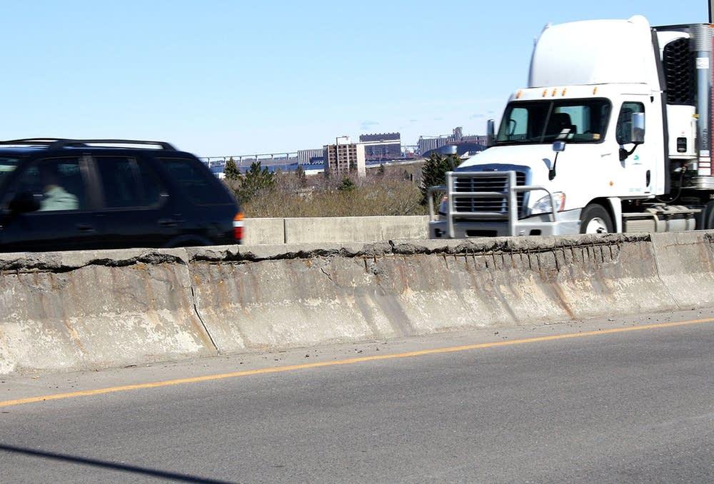 Crumbling traffic wall