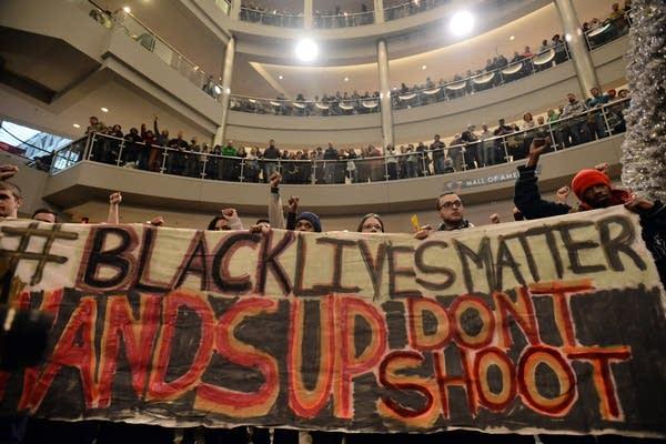 "Chanting ""Black lives matter"""