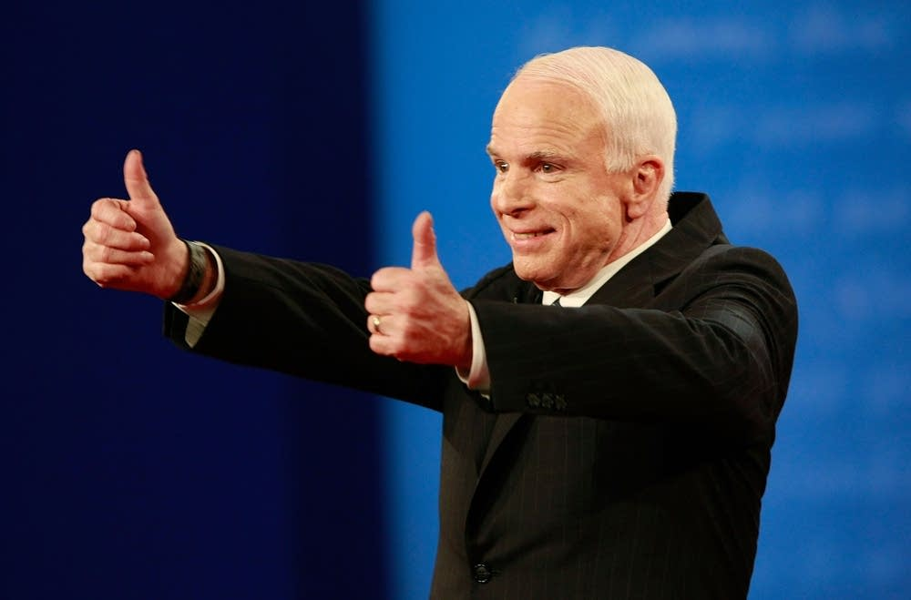 John McCain gestures to the crowd