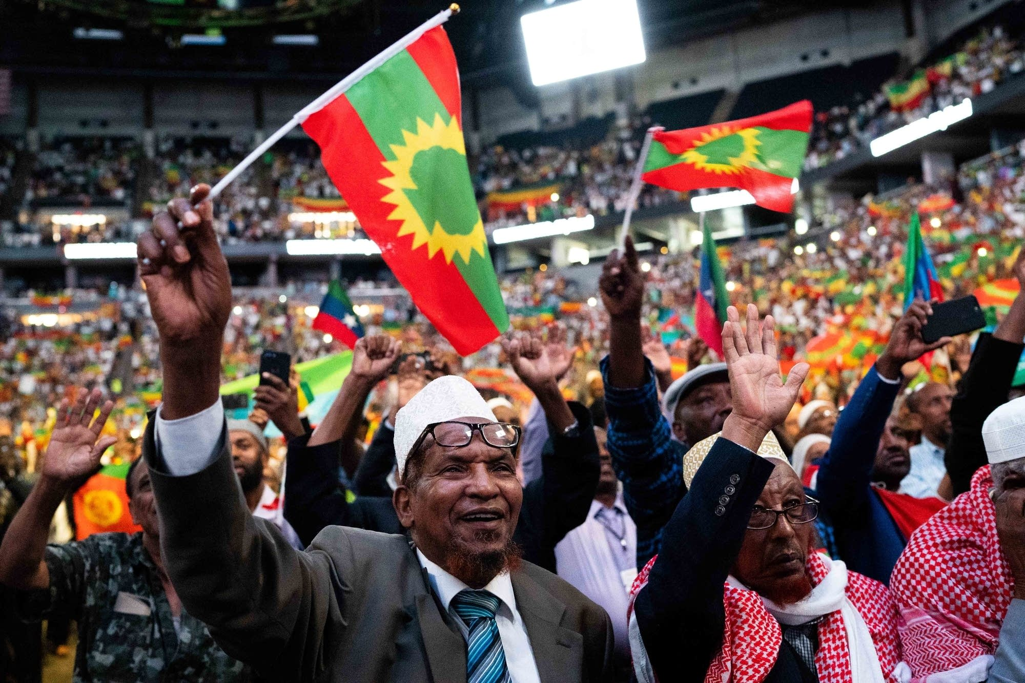 Supporters of Ethiopian Prime Minister Abiy Ahmed wave flags.