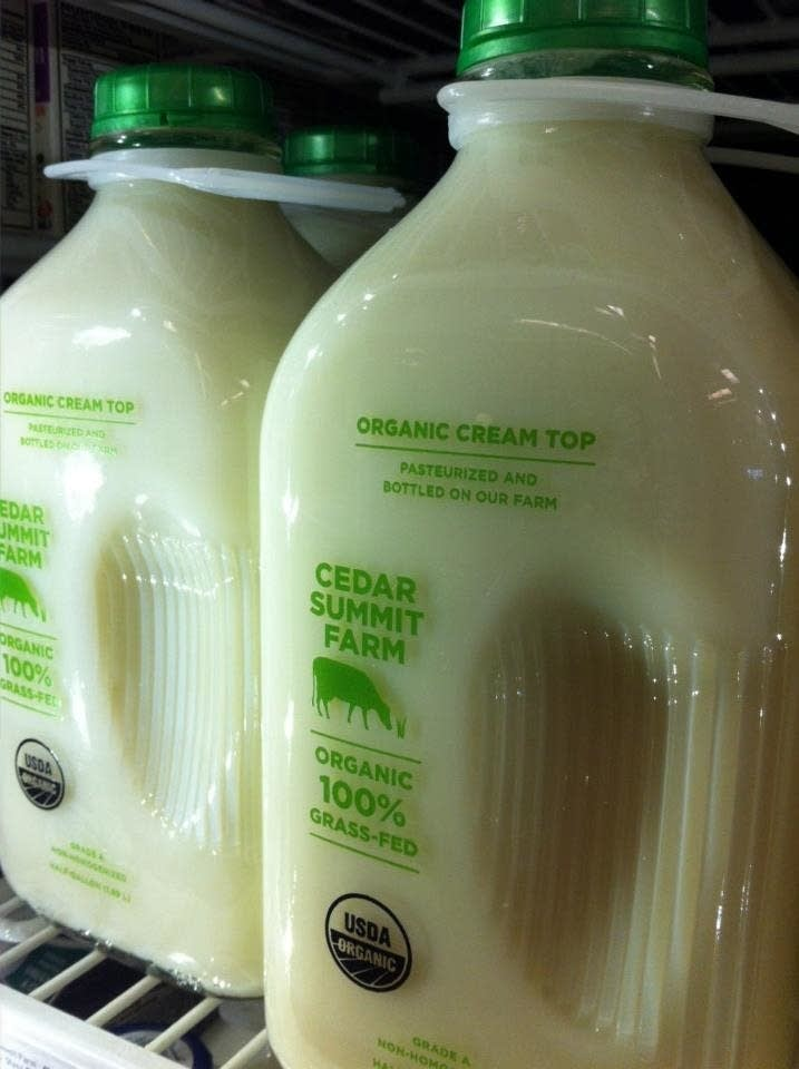 Bottles of Cedar Farm Milk