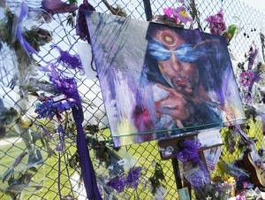A painting of Prince is displayed.